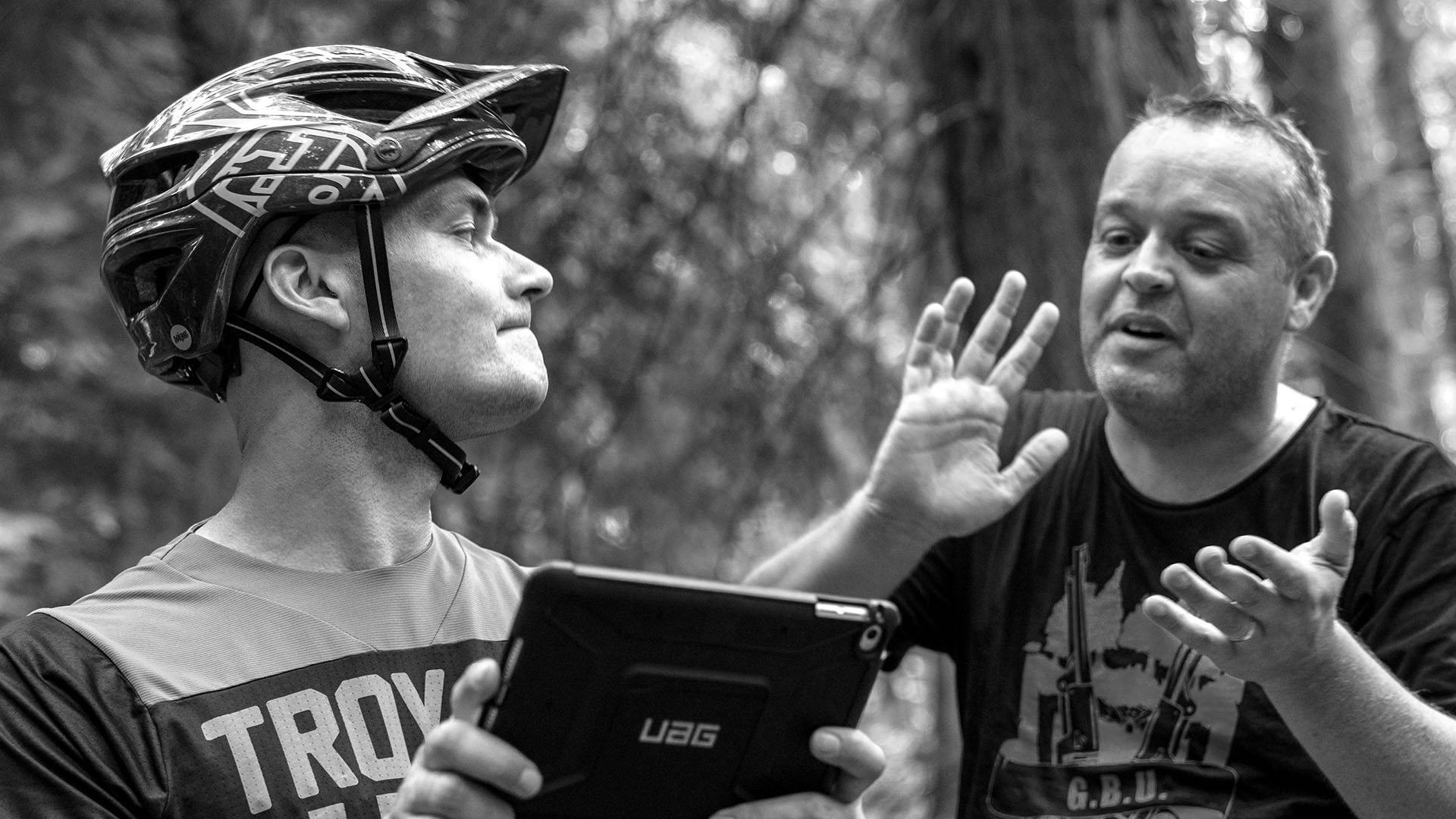 +3 Coach Alan Milway showing a rider his technique on the iPad
