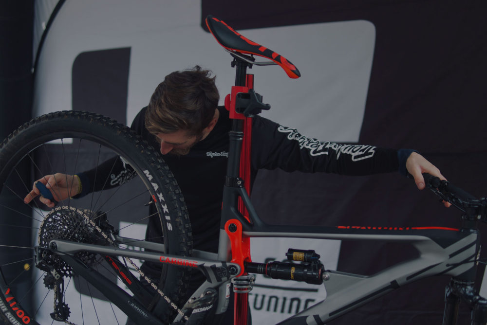 Will Soffe adjusting the gears with an Intense Bikes UK rider in the Forest of Dean