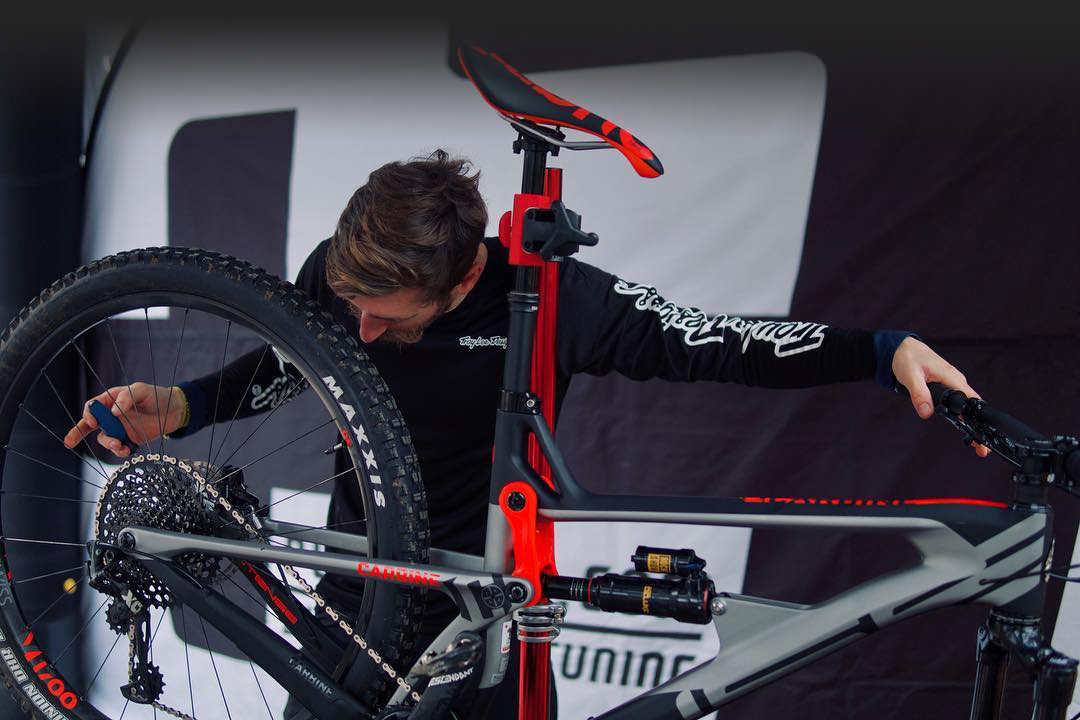 Will Soffe working on a customer bike ready for a day of coaching and tweaking